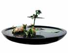 EL36 <br>  Krishna in a Lotus Pond – II <br> Bronze on Granite <br> 26 x 27 x 13 inches <br> Available